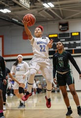 Moorpark College freshman Breanna Calhoun takes the ball to the hoop against Diablo Valley College during the CCCAA state championship game at Ventura College on Sunday. Moorpark lost, 68-61.