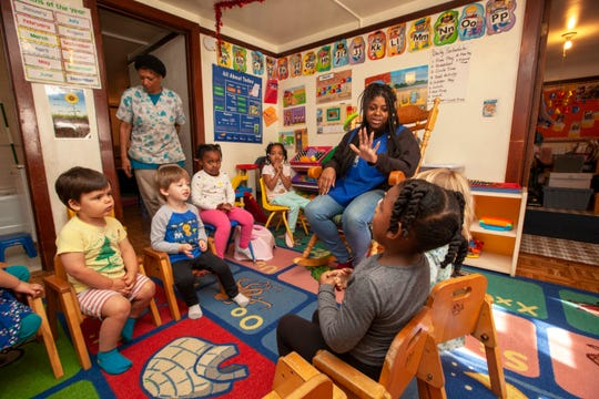Teachers Yolanda Wilson and Kyla Kinner lead children in a lesson at Lil Nancy's Primary Schoolhouse in West Oakland.