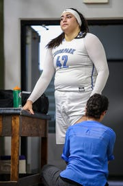 Moorpark College's Barbara Rangel gets treatment from trainer Cherisse Meichtry after injuring her knee in the third quarter against Diablo Valley College during the CCCAA state championship game at Ventura College on Sunday. Moorpark lost, 68-61.