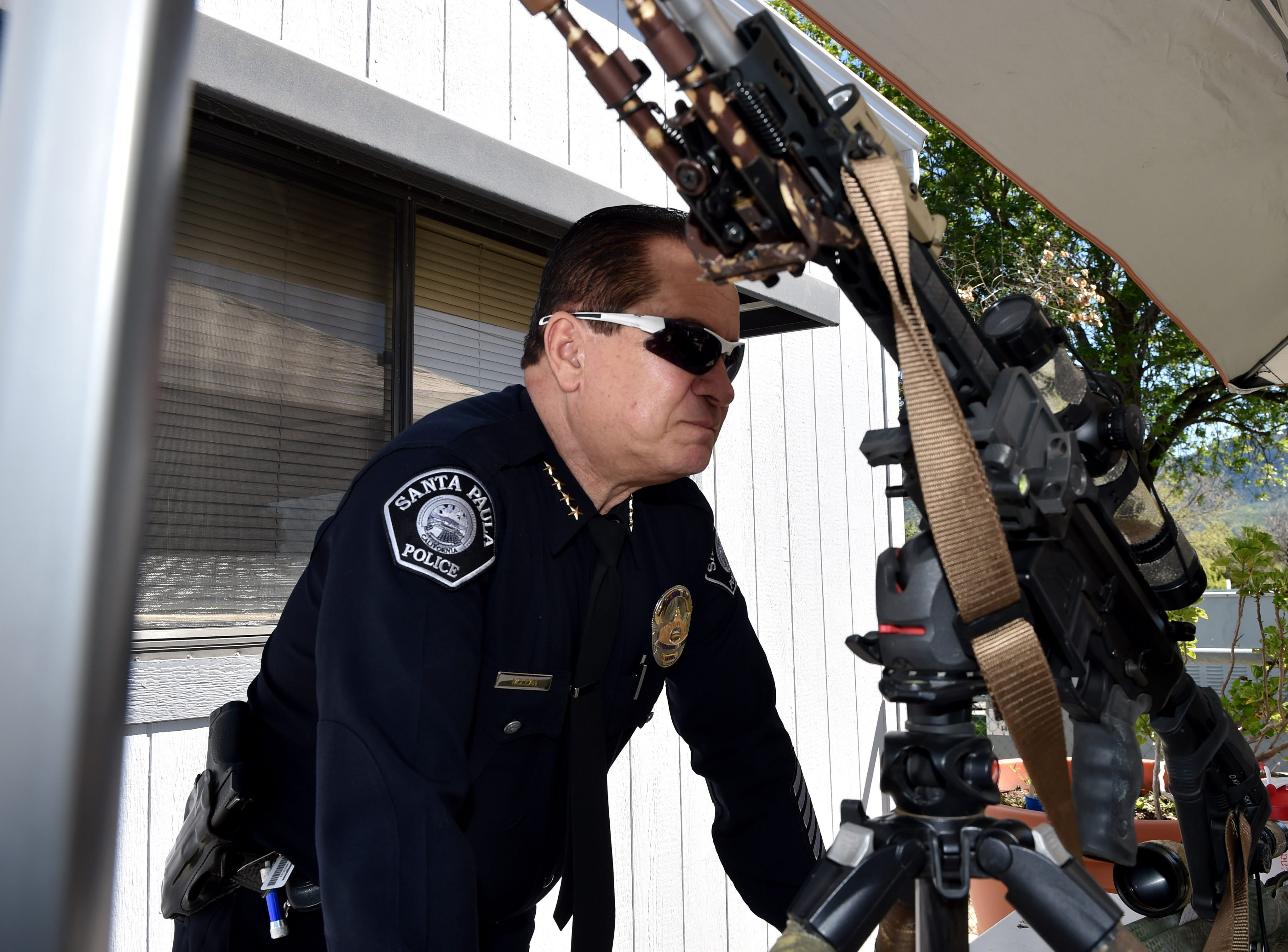 Santa Paula Police Chief Steven McLean visits a demonstration station during an event at his department's youth center on Friday.