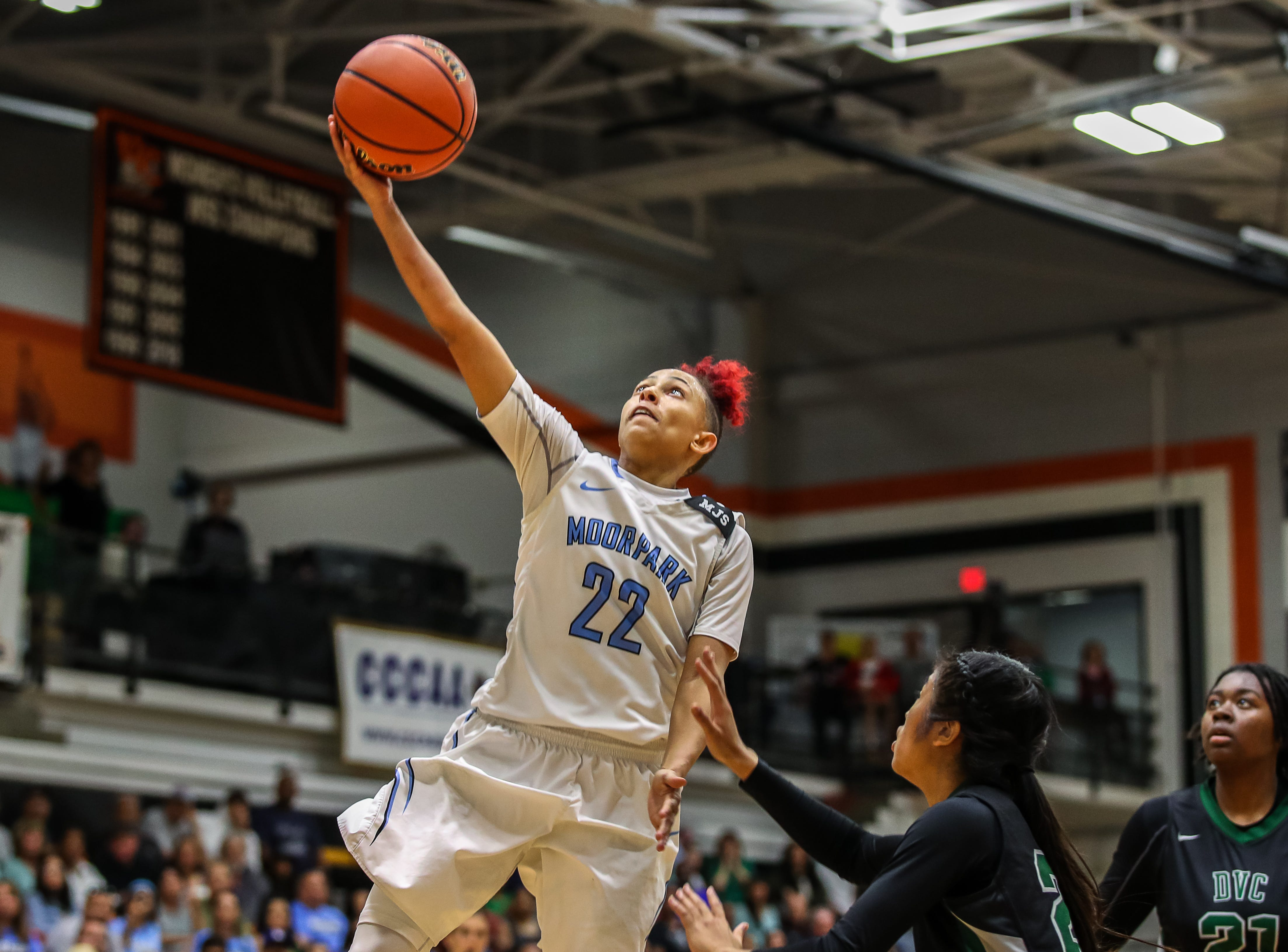 Moorpark College's Freshman Breanna Calhoun drives to the hoop against Diablo Valley College during the CCCAA state championship game at Ventura College on Sunday. Moorpark lost, 68-61.