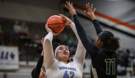 Moorpark College's Barbara Rangel shoots a jumper over Diablo Valley College's Leilani Moncrease during the CCCAA state championship game at Ventura College on Sunday. Moorpark lost, 68-61.
