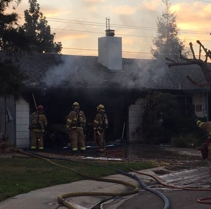 Family of two escapes burning Visalia home, cat dies in blaze