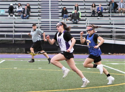 John Jay-Cross River's Charlotte Wilmoth carries the ball up the field, pursued by Mahopac's Tatiana Moran during a March 15, 2019 scrimmage.