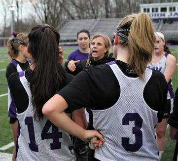 Coach Stacey Wierl talks to her John Jay-Cross River girls lacrosse players during a March 15, 2019 scrimmage.