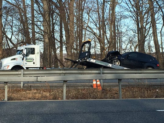 One of the vehicles is towed after a four-vehicle crash on Interstate 684 that backed up the southbound highway for miles during the morning rush on Monday, March 18, 2019.