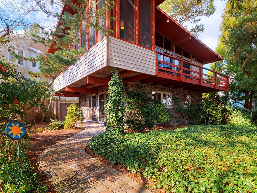 38189 Terrace Road in Rehoboth Beach is a Frank Lloyd Wright type style beach house 3 blocks from the ocean and boardwalk in Silver Lake Manor. The 2 bedroom, 2 full baths 1,172 square feet home was built in 1966 and is listed at  $1,495,000. For more information contact Celia Benjamin 301-370-7588 at The Oldfather Group of Ocean Atlantic Sotheby's International Realty.