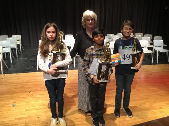 Left to right:  Isabel Palmer in second place, Anne Marie Eanes, English Department Chair at Saint Mark's, Sahil Langote in first place and  Sage Sawhney in third place.