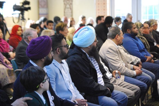 Delawareans listen during a prayer vigil held at at the Masjid Isa Ibn-e-Maryam mosque Sunday, March 17.
