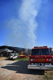 Smoke rises from a hay barn fire on Pecanway Drive Monday morning. Cameron Gardens Volunteer Fire Department and several others worked together to control the fire.