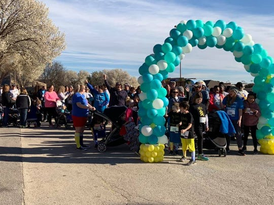 More than 100 people took part in  Saturday's fun run for The Upside-- Advocacy and Awareness for Individuals with Down Syndrome. The nonprofit was started by Wichita Falls mother Misti Brock and a team of friends and family after her son Axel was born.