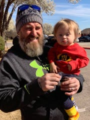 Scott and Azel Brock, the inspiration for newly organized nonprofit, The Upside -- Advocacy and Awareness for Individuals with Down Syndrome, take part in Saturday's fun run.