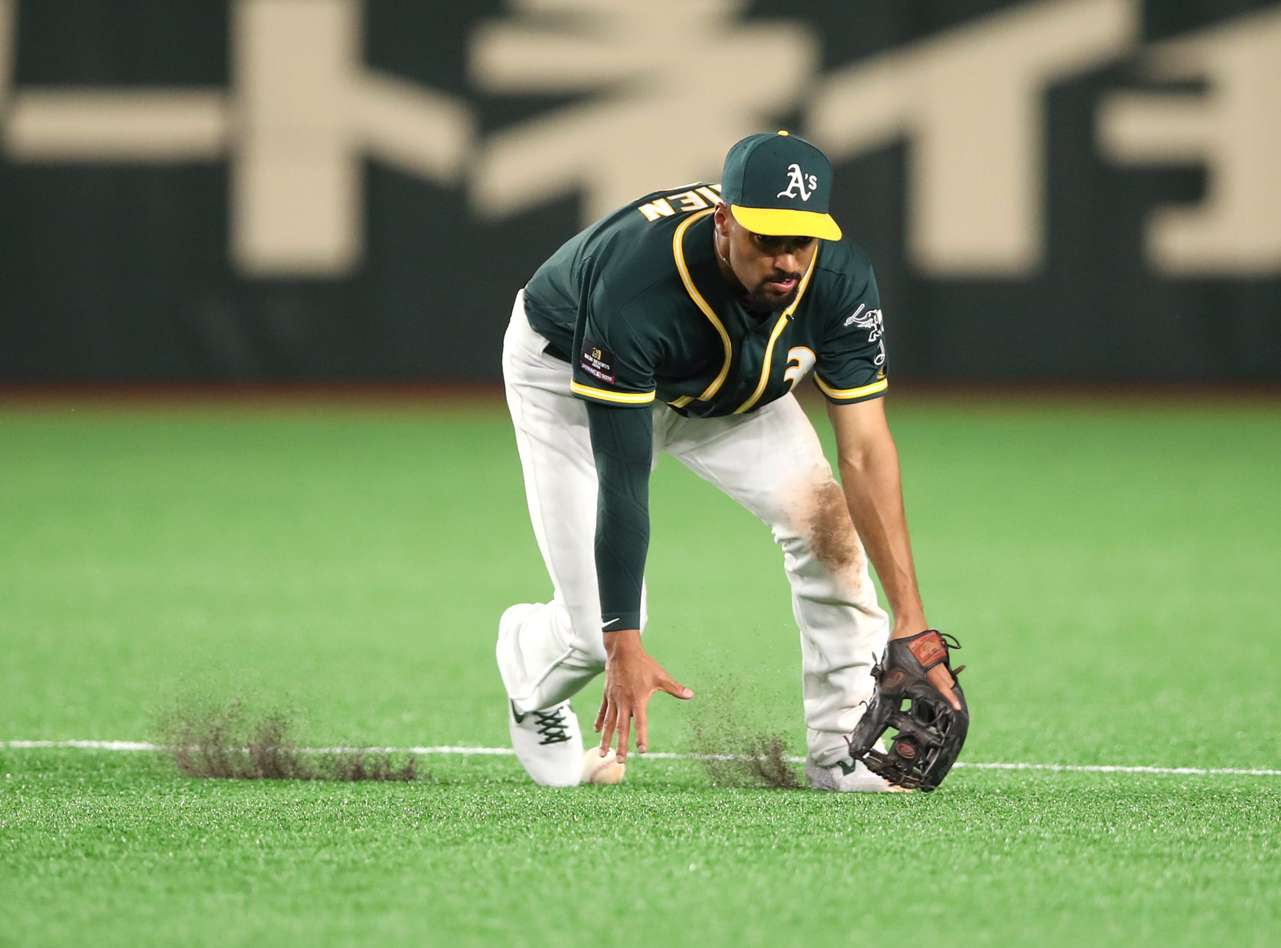 March 18: Athletics shortstop Marcus Semien mishandles a ground ball against the Nippon Ham Fighters at the Tokyo Dome.