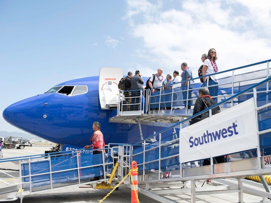 Southwest Airlines' inaugural Hawaii flight arrives at Daniel K. Inouye International Airport in Honolulu on Sunday.