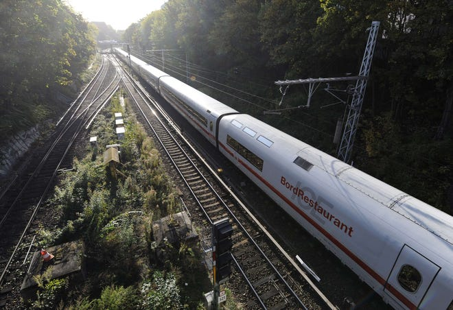 This picture taken on Oct. 5, 2009 shows a high-speed Inter-City Express (ICE) train of German railway operator Deutsche Bahn making its way.