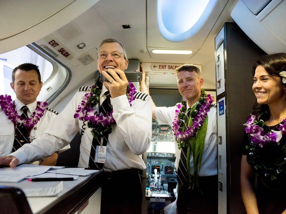 Captain Michael Styer greets passengers on Southwest Airlines' inaugural Hawaiian flight to Honolulu, Hawaii.