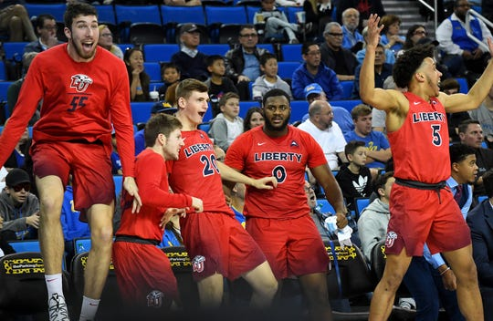 Liberty Flames players celebrate after upsetting UCLA earlier this season.