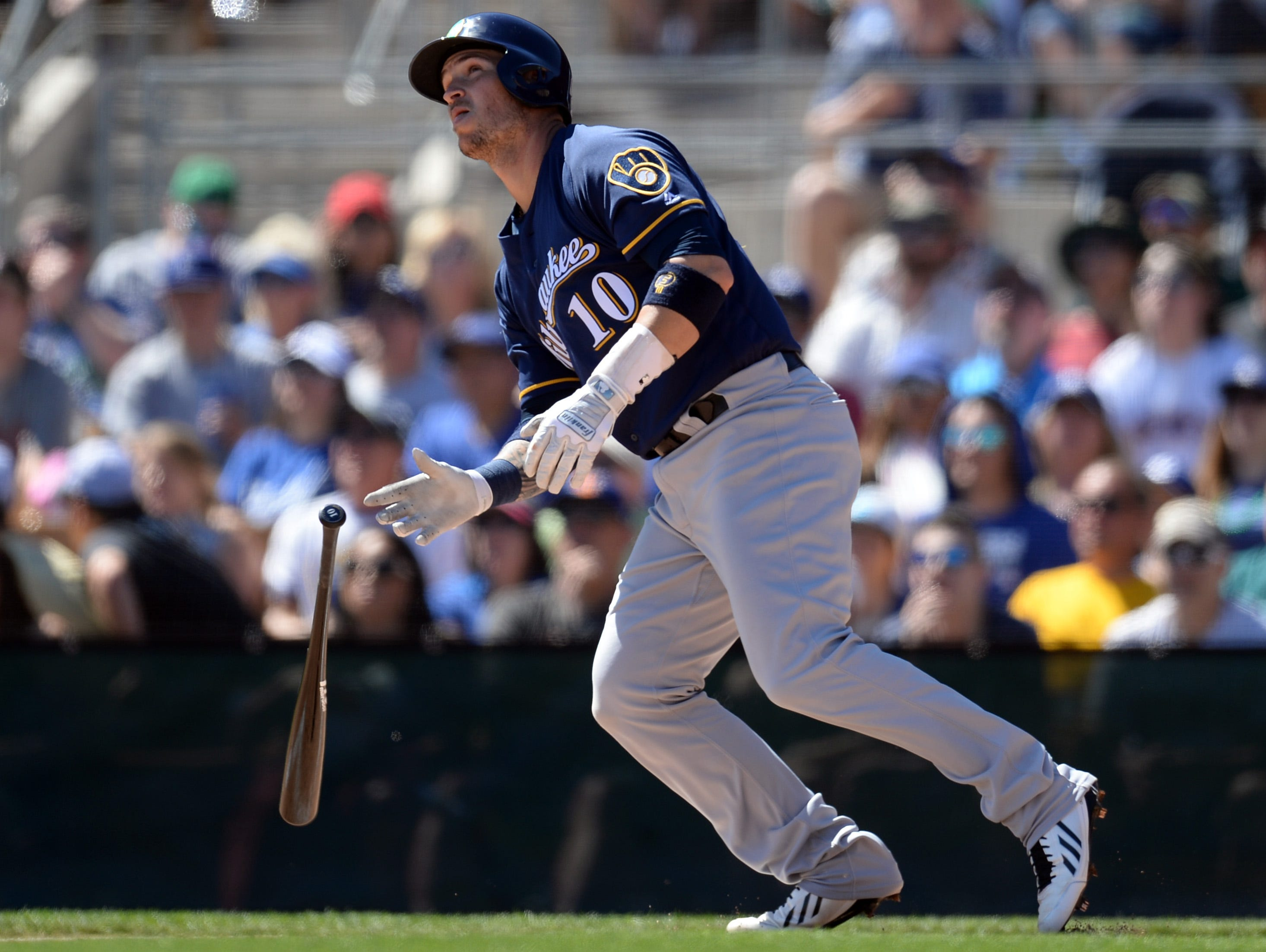 March 17: Brewers catcher Yasmani Grandal runs to first against the Dodgers.