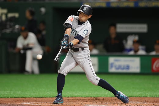 March 18: Mariners outfielder Ichiro Suzuki swings during a game against the Yomiuri Giants at the Tokyo Dome.