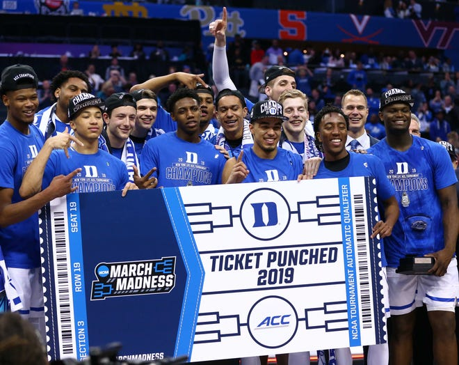 Duke players celebrate after winning the ACC conference tournament.