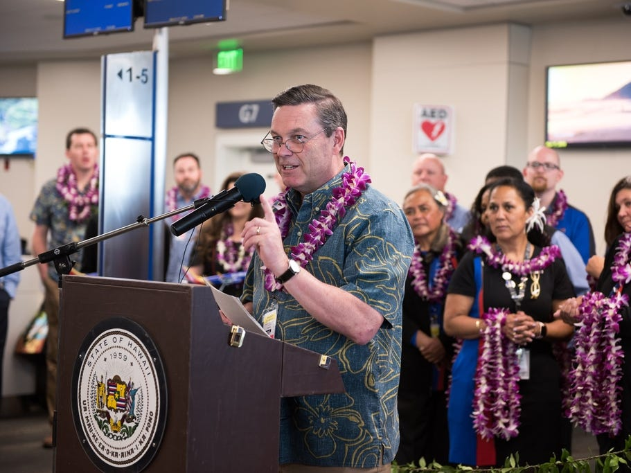 Southwest Airlines President Tom Nealon greets passengers of the airline's inaugural flight to Hawaii as they arrive in Honolulu.