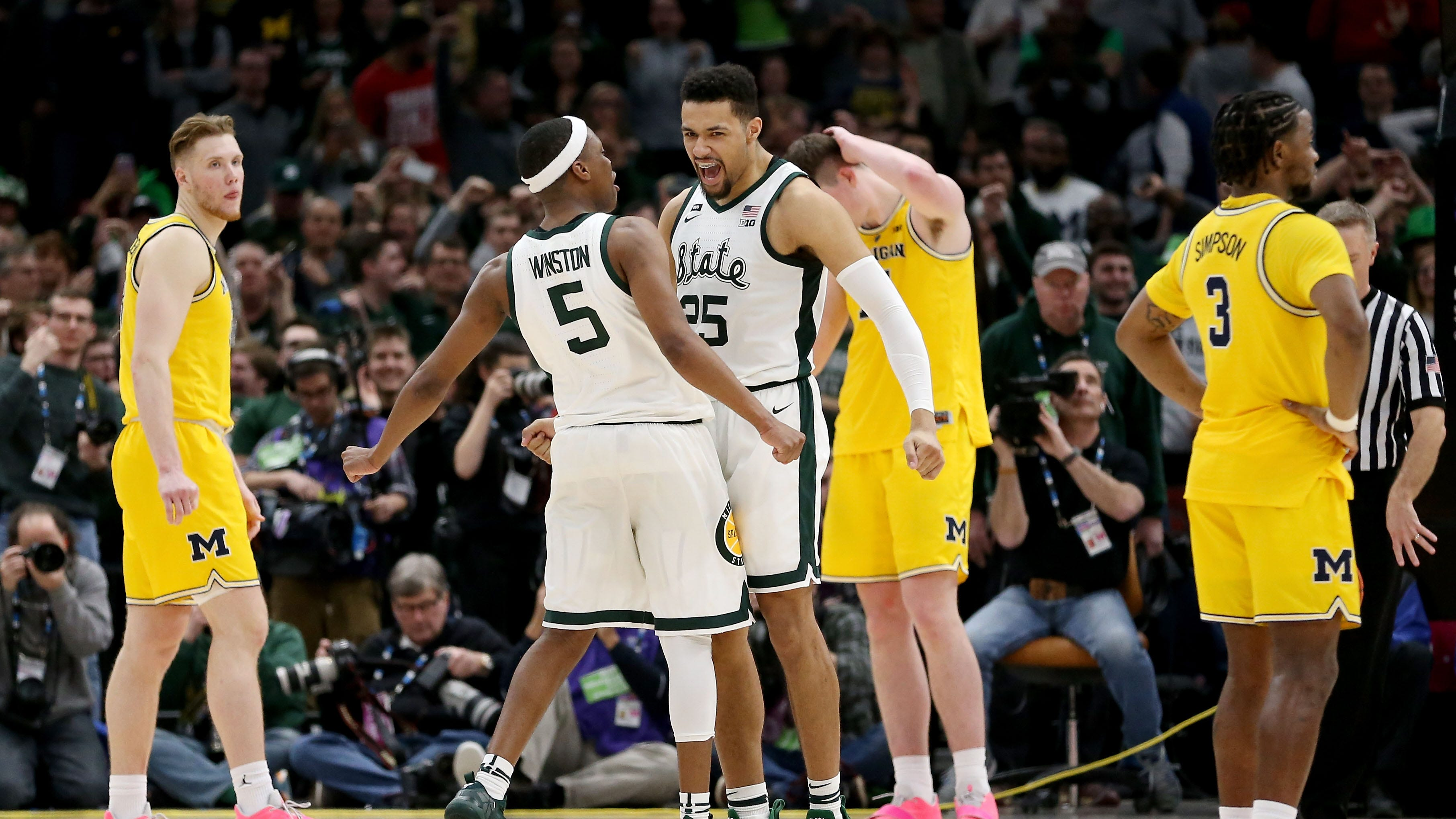 Michigan State's Cassius Winston and Kenny Goins celebrate beating Michigan in the Big Ten tournament final.