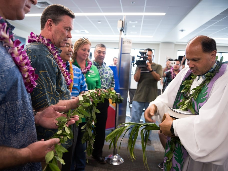 A blessing is performed after Southwest lands at Daniel K. Inouye International Airport in Honolulu.