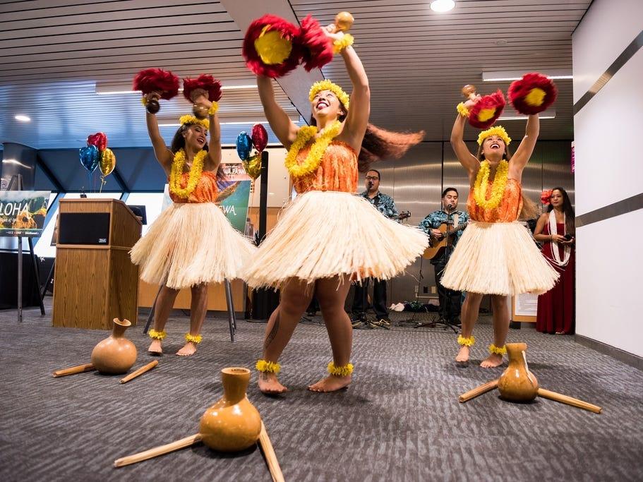 Hulu dancers from Hapa Hula perform during Southwest Airlines' inaugural Hawaiian flight festivities at Oakland International Airport.