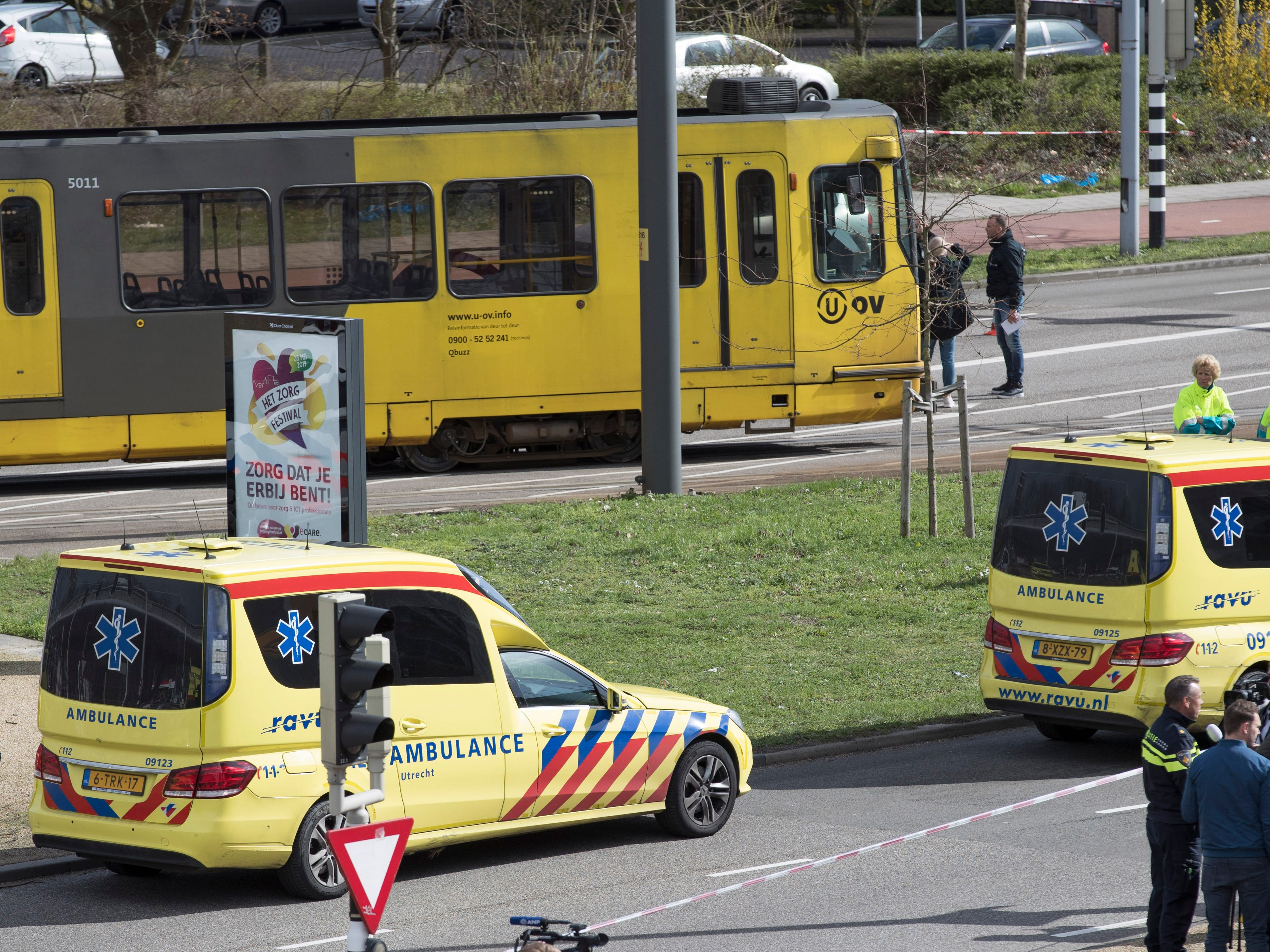 """Ambulances are seen next to a tram after a shooting in Utrecht, Netherlands, March 18, 2019. Police in the central Dutch city of Utrecht say on Twitter that """"multiple"""" people have been injured as a result of a shooting in a tram in a residential neighborhood."""