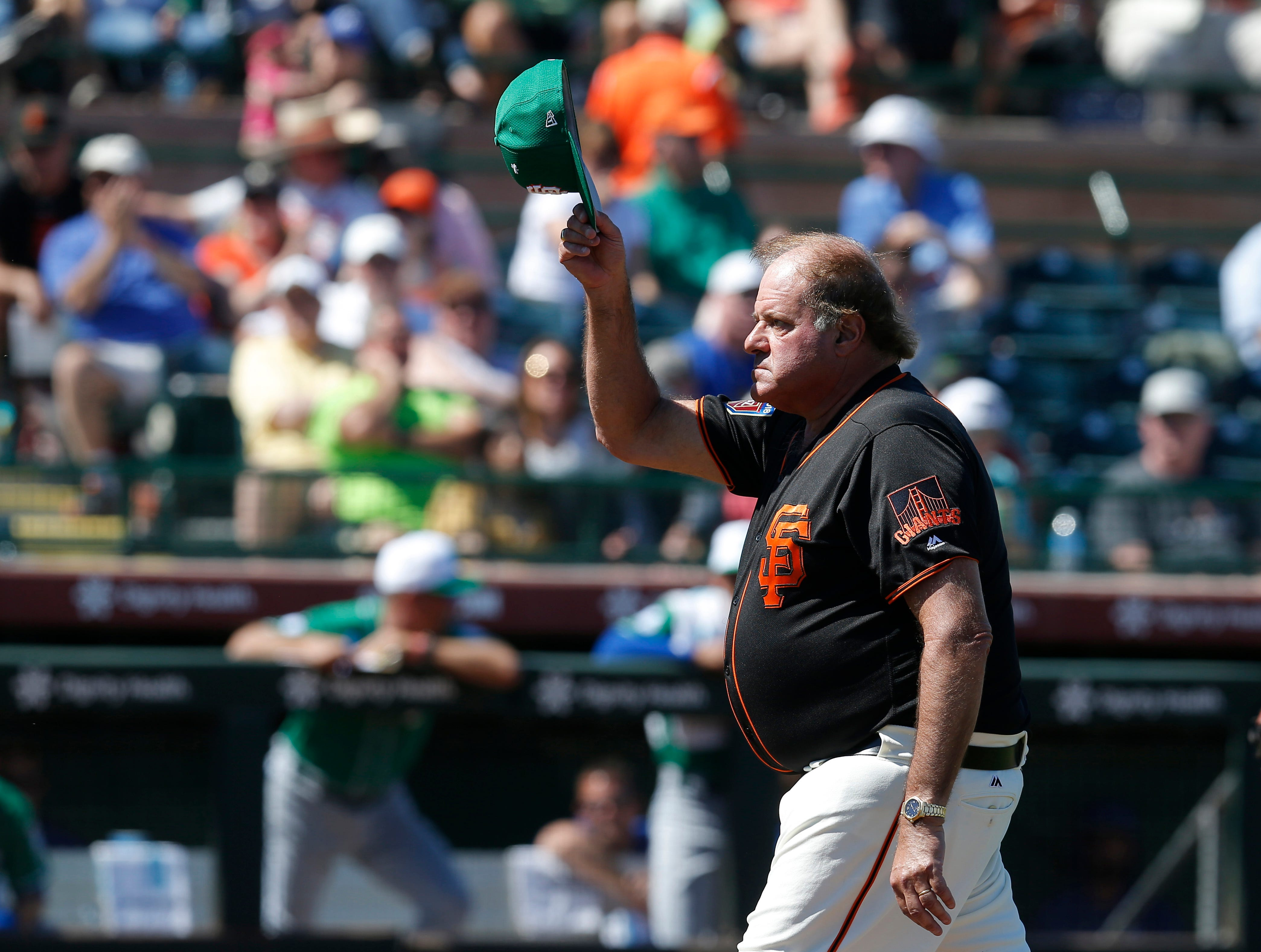 March 17: Chris Berman acknowledges the fans during a game between the Giants and Royals.
