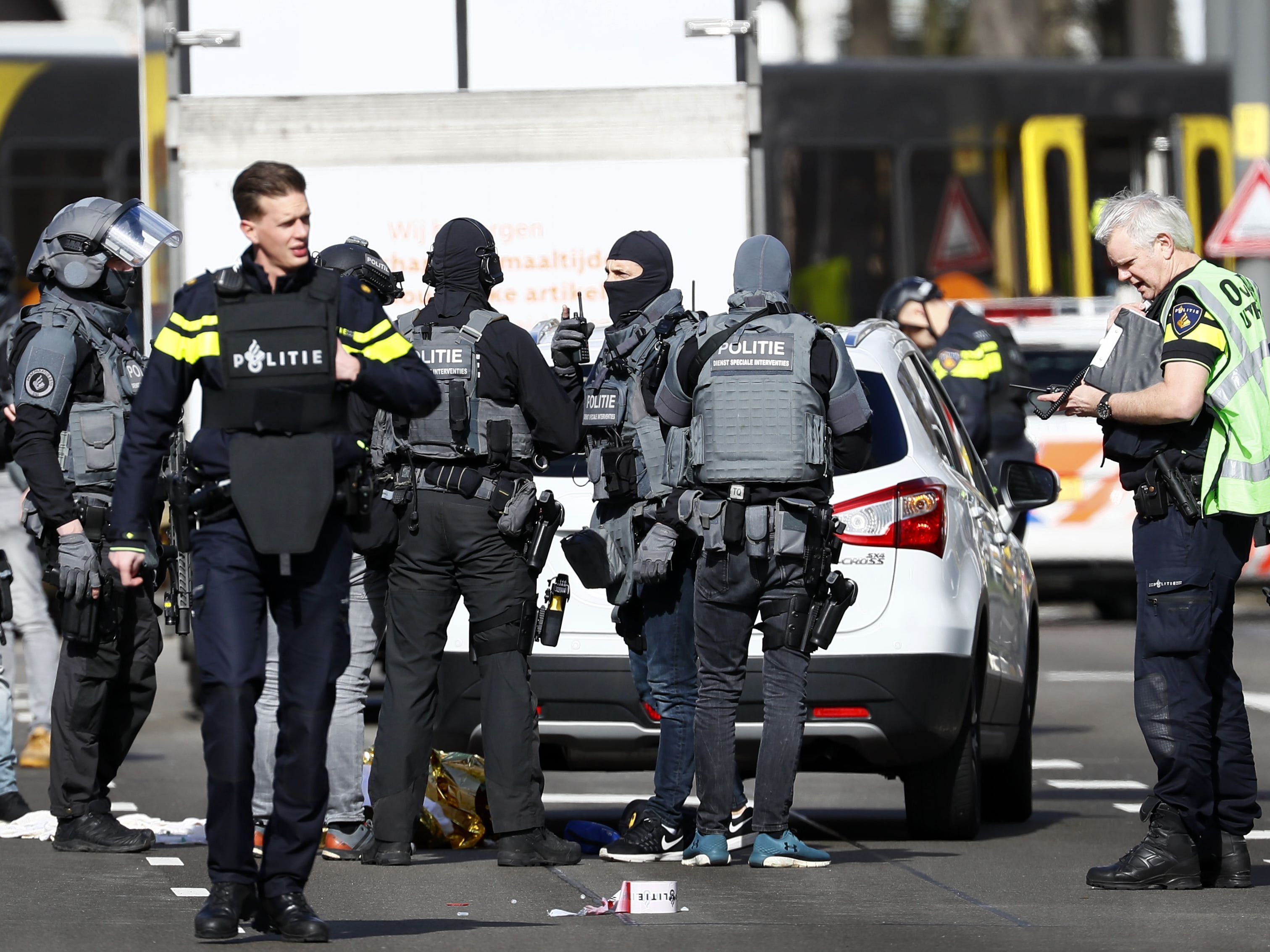 Police forces stand near a tram at the 24 Oktoberplace in Utrecht, on March 18, 2019 where a shooting took place.