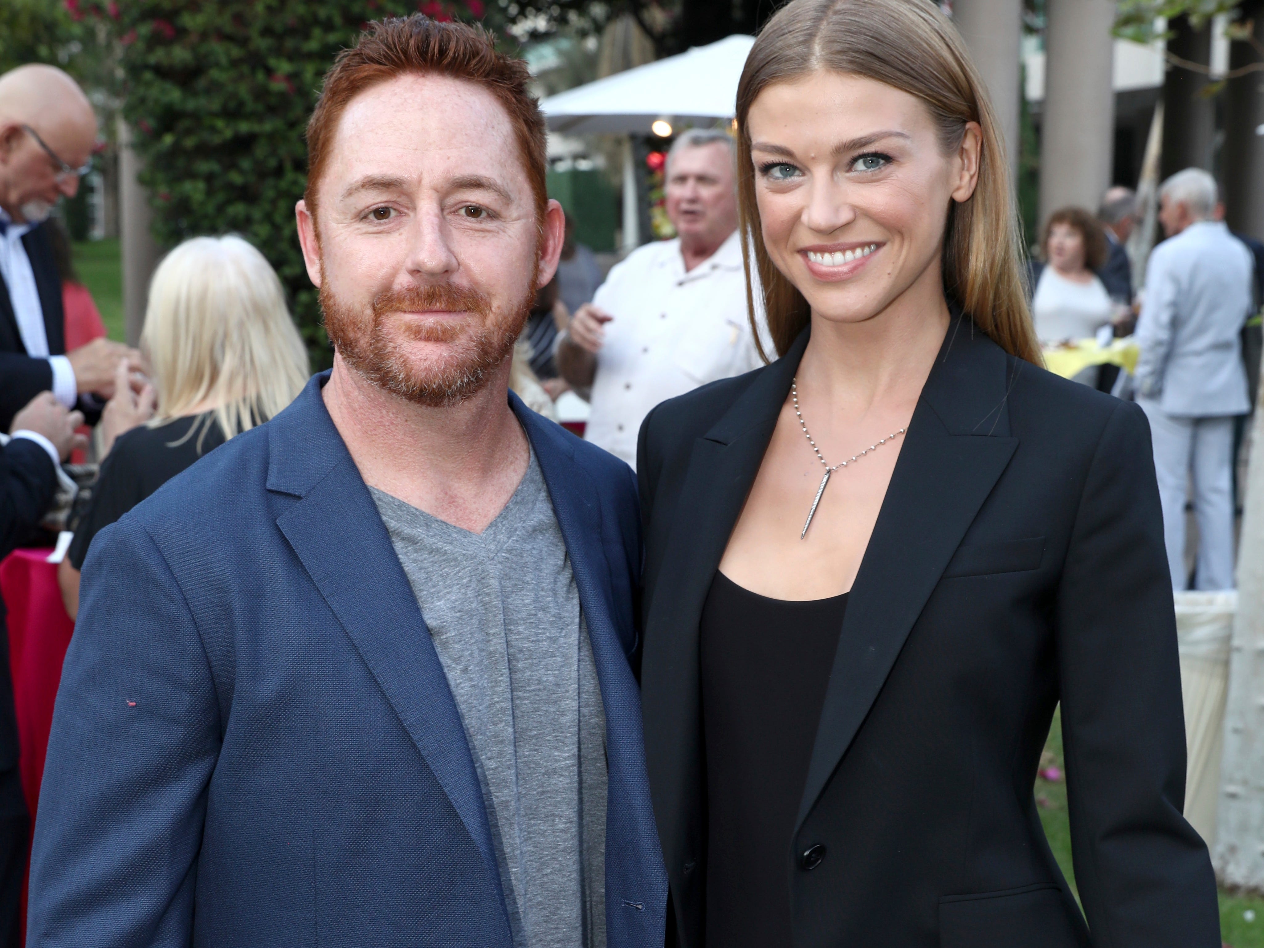"IMAGE DISTRIBUTED FOR THE TELEVISION ACADEMY - Scott Grimes, left, and Adrianne Palicki attend the 12th annual ""Art of Television Costume Design"" opening at the FIDM Museum & Galleries on the Park on Saturday, Aug. 18, 2018, in Los Angeles. (Photo by Matt Sayles/Invision for the Television Academy/AP Images) ORG XMIT: CALB104"