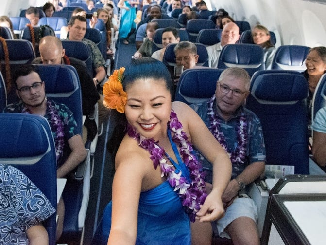 Hulu dancers from Hapa Hula perform during Southwest Airlines' inaugural Hawaiian flight to Honolulu, Hawaii, out of Oakland, California.