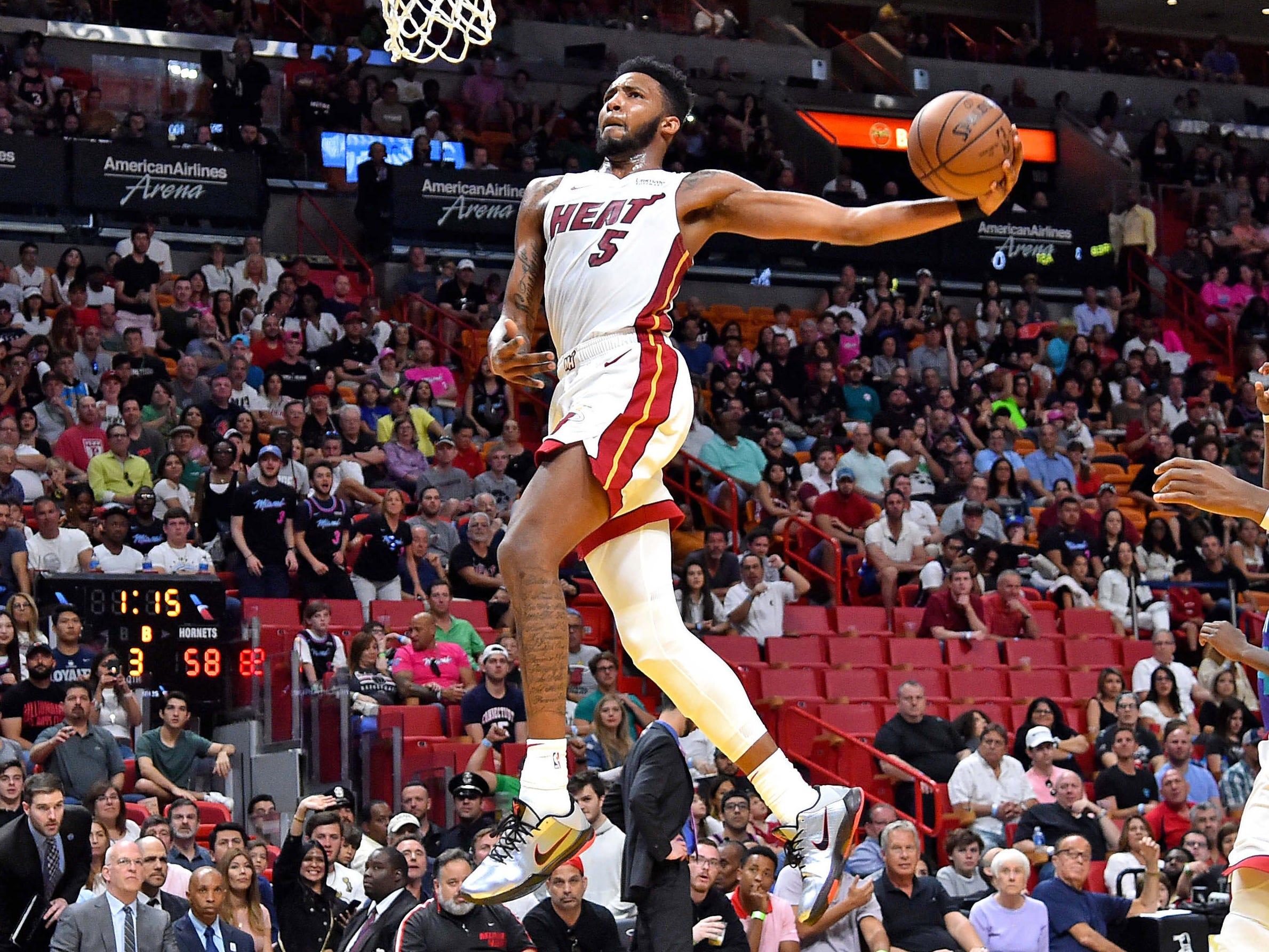 March 17: Heat forward Derrick Jones Jr. rises up for the monster one-handed jam against the Hornets.
