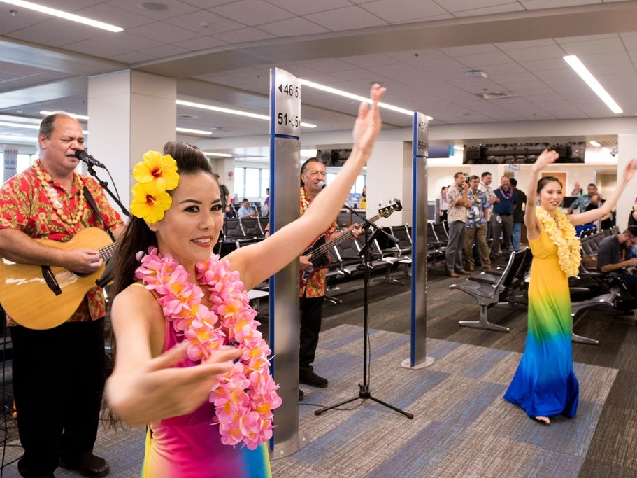 Travelers were greeted with music and hula dancers as they arrived from Oakland to the Daniel K. Inouye International Airport in Honolulu.