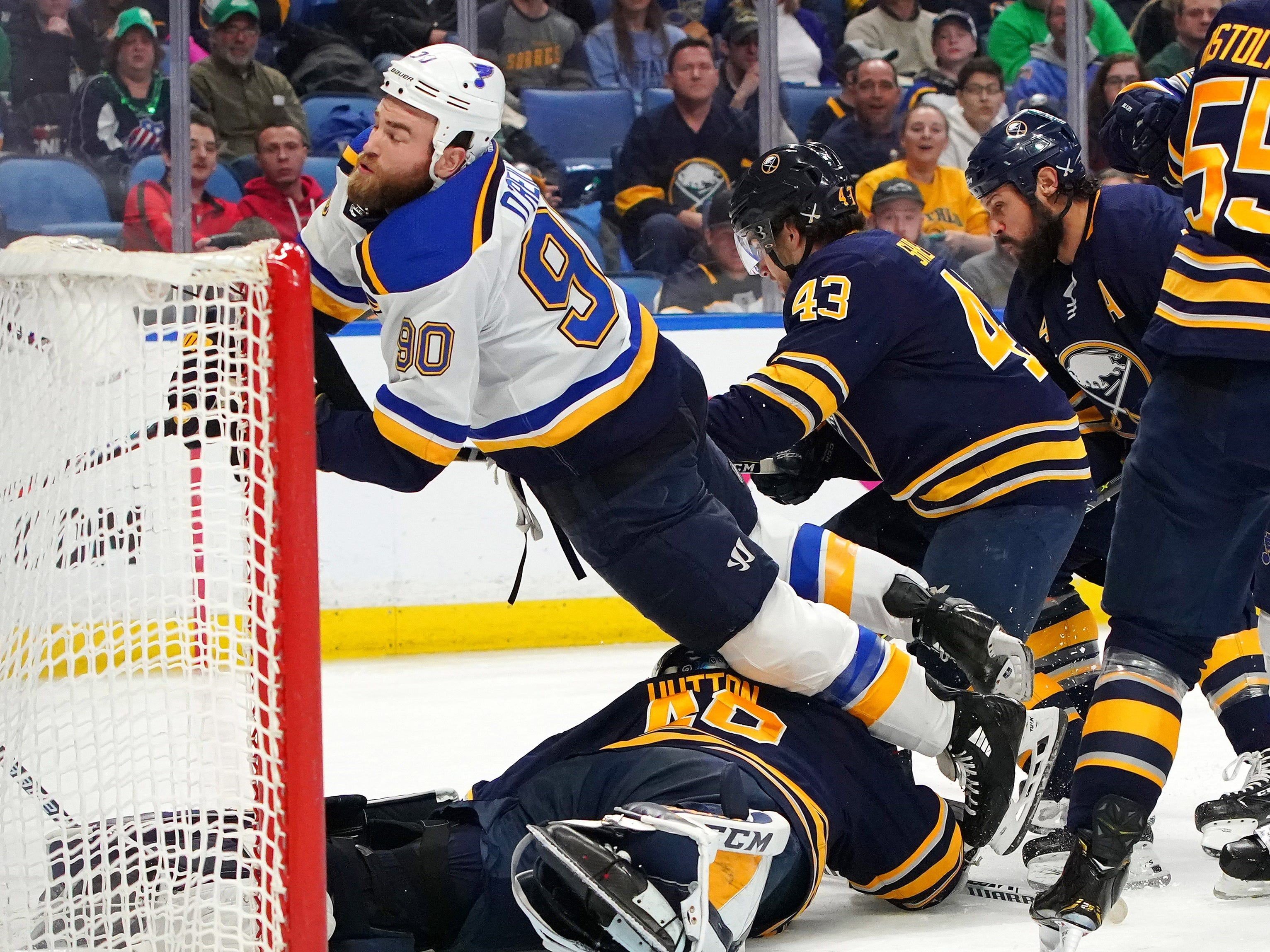March 17: St. Louis center Ryan O'Reilly (90) goes flying over Buffalo Sabres goaltender Carter Hutton (40) during the third period. The Sabres topped the Blues 4-3 in a shootout.