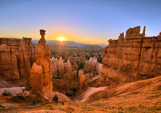 Bryce Canyon National Park in Utah is especially beautiful as sunrise or sunset brings added color to the already-vibrant hoodoos.