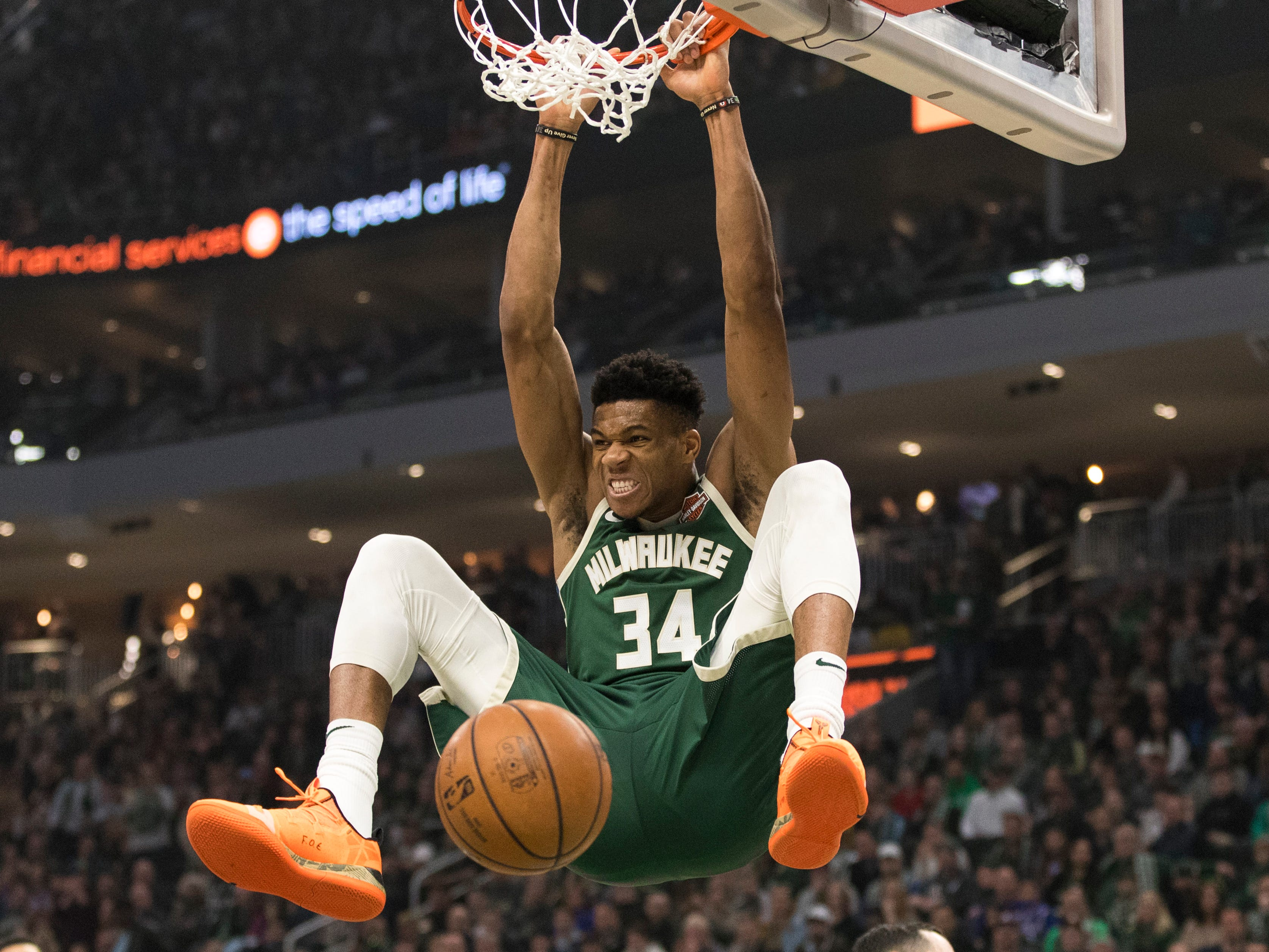 March 17: Bucks star Giannis Antetokounmpo throws down the thunderous two-handed slam against the 76ers.
