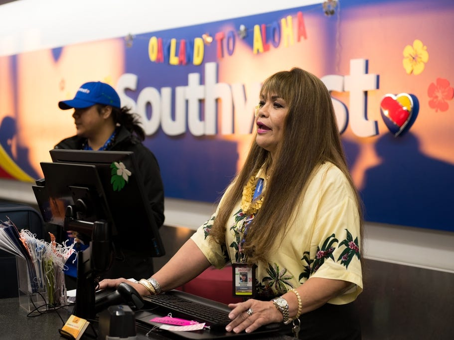 Southwest Airlines' inaugural flight to Hawaii was from Oakland, California, to Honolulu March 17. The airline is planning more routes from California to the Hawaiian Islands, and even inter-island routes, over the next several months. A gate agent checks in passengers at Oakland International Airport.