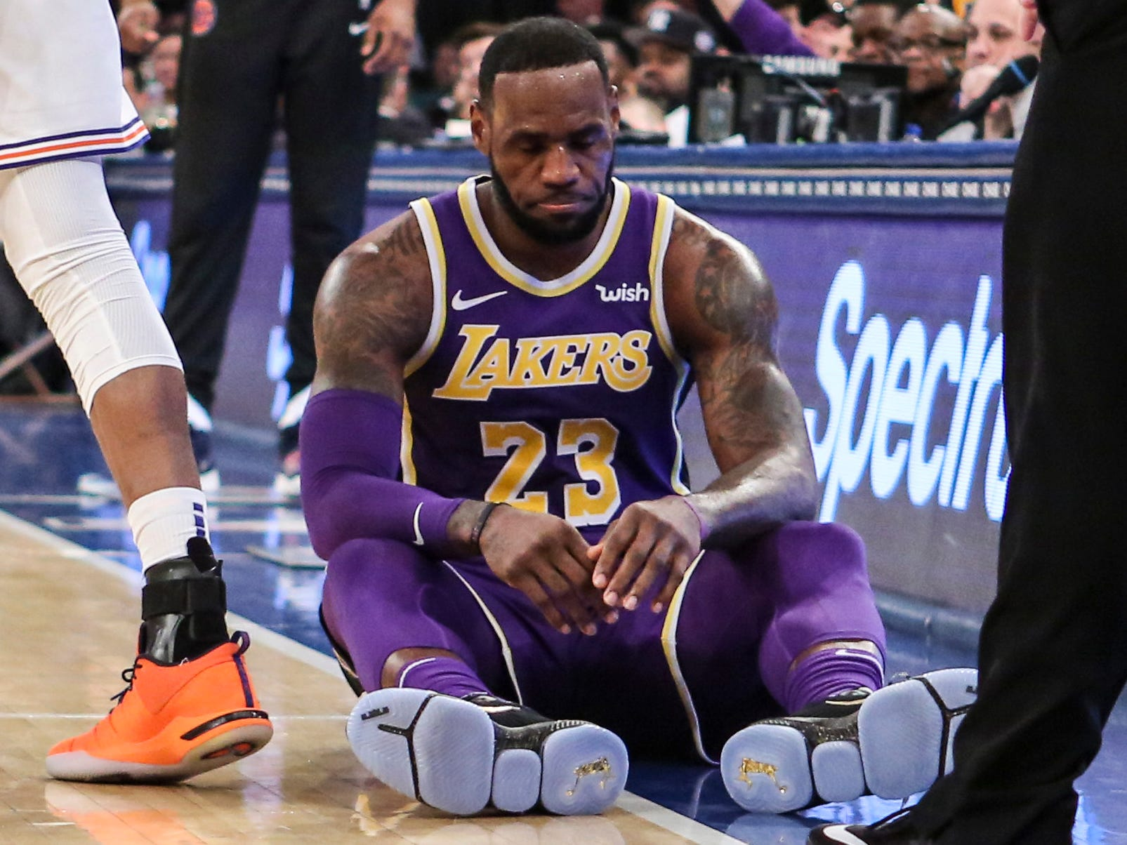 March 17, 2019: LeBron James takes his time getting up off the floor after a being fouled against the Knicks at Madison Square Garden.