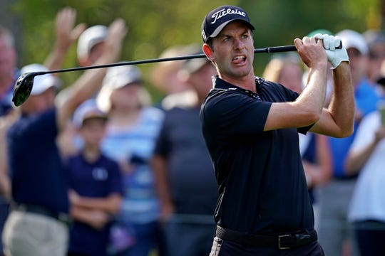 Webb Simpson was assessed a one-shot penalty Sunday for inadvertently moving his ball on the 14th hole at the Players Championship.