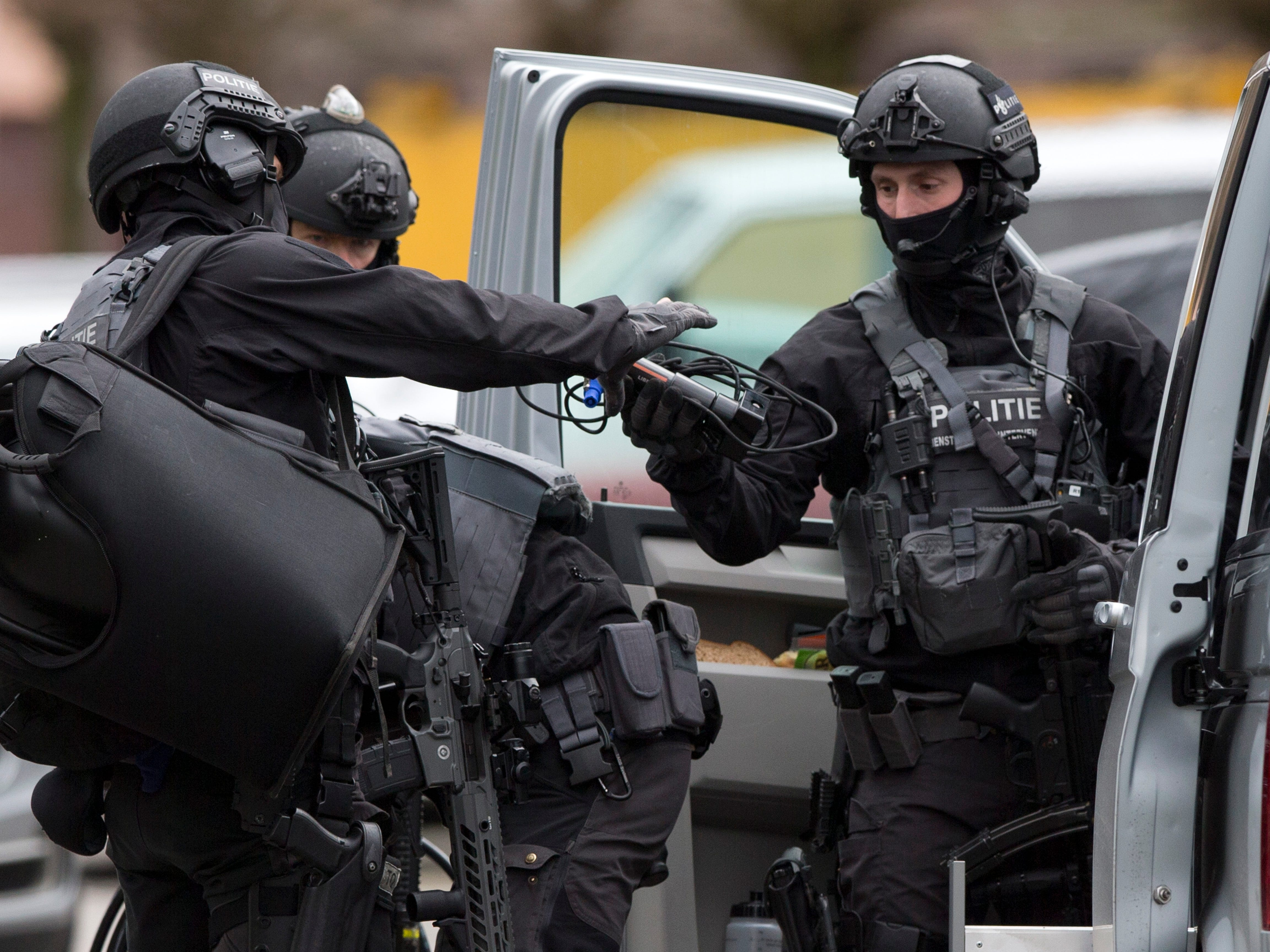 Dutch counter terrorism police prepare to enter a house after a shooting incident in Utrecht, Netherlands, March 18, 2019.