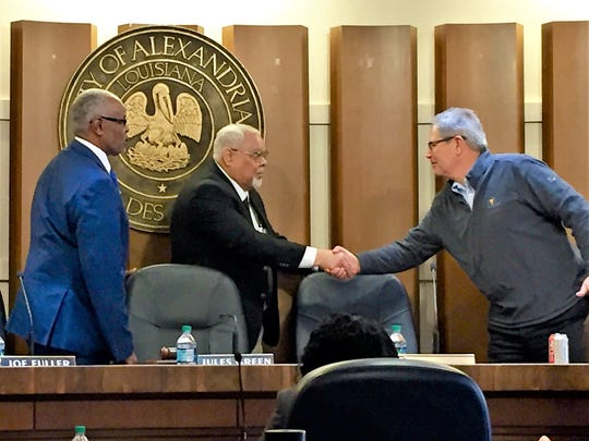 Ronland Dejoie (center) is welcomed by fellow Alexandria City Councilmen Jules Green (left) and Jim Villard (right) as he takes his seat on the council Monday.