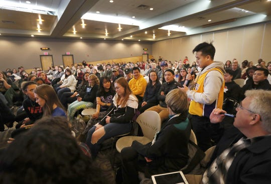 Jason Yang, a freshman at the University of Wisconsin-Oshkosh, speaks to the crowd during the Call for Action Forum in the Reeve Union at the University of Wisconsin-Oshkosh Monday, March 18, 2019, in Oshkosh, Wis.