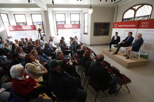 Congressmen Mike Gallagher and Mark Pocan talk about what it means to be American at the History Museum at the Castle in Appleton on Tuesday.