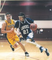Kyle MacGillis of Lawrence University takes the ball to the basket against UW-Stevens Point during the 2004 NCAA Division III Elite 8 game in Tacoma, Washington.