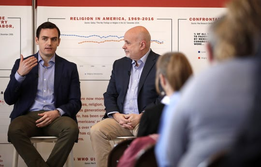Republican Congressman Mike Gallagher and Mark Pocan, a Democrat, discuss shared values at the History Museum at the Castle in Appleton on Tuesday.