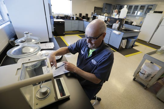 Lab director Steven Vickstrom conducts compliance tests at the Fox West Regional Wastewater Treatment Plant in Fox Crossing.