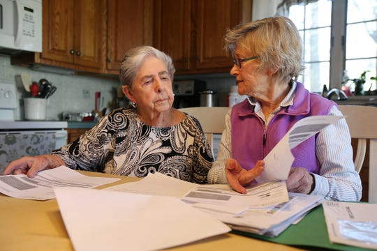 Doris Horn of Parsipanny, a Medicare recipient who received a bunch of robocalls from scammers offering free medical braces, discusses all of her paperwork with her neighbor and friend, Mary Purzycki, at her home in Parsippany, NJ Tuesday, March 19, 2019. A full set of medical braces she didn't order and doesn't need arrived at her home and Westside Medical Braces was paid by Medicare and her second insurer. She has returned the braces and a second box of braces from a different company that she also received.