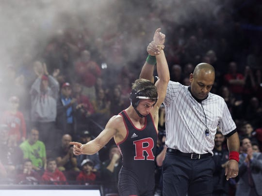 Nick Suriano, shown getting his hand raised after he won by pin against Penn State on Jan. 28, 2018, will, along with Anthony Ashnault, try and become Rutgers' first NCAA wrestling champions this weekend